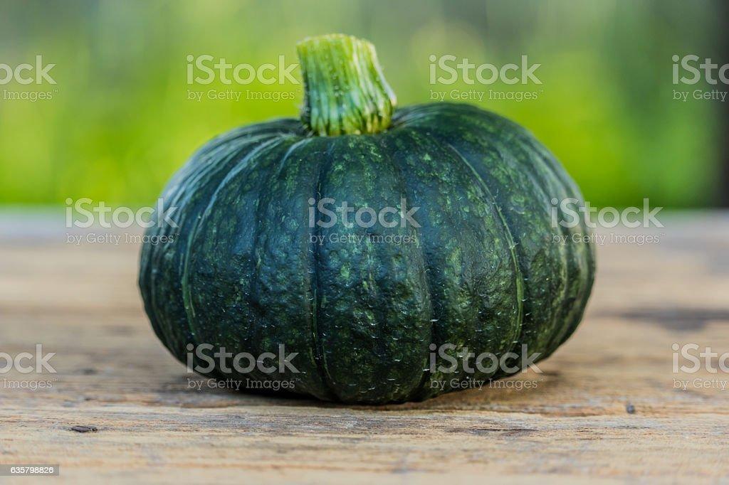 Japanese pumpkin on wooden board stock photo