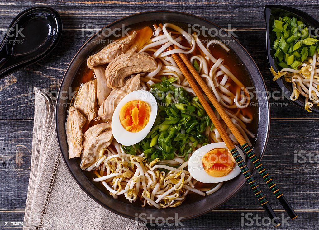 Japanese ramen soup with chicken, egg, chives and sprout. stock photo
