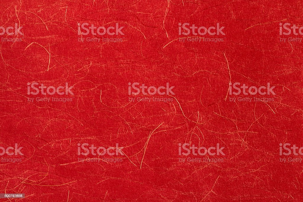 Japanese red paper with gold thread. stock photo