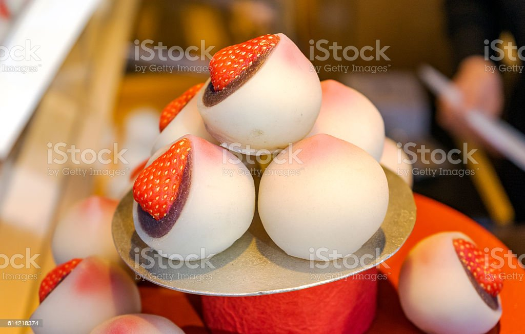 Japanese rice cake stuffed with strawberry for display at shop stock photo