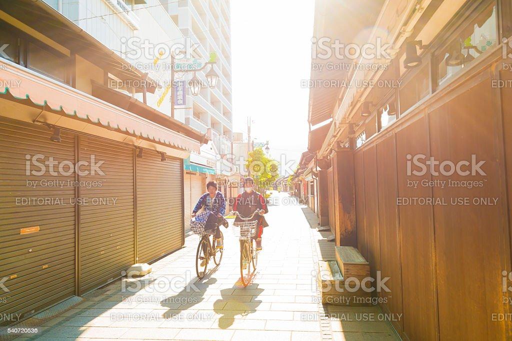 Japanese Ride Bicycles in Historic Matsumoto Japan Streets stock photo