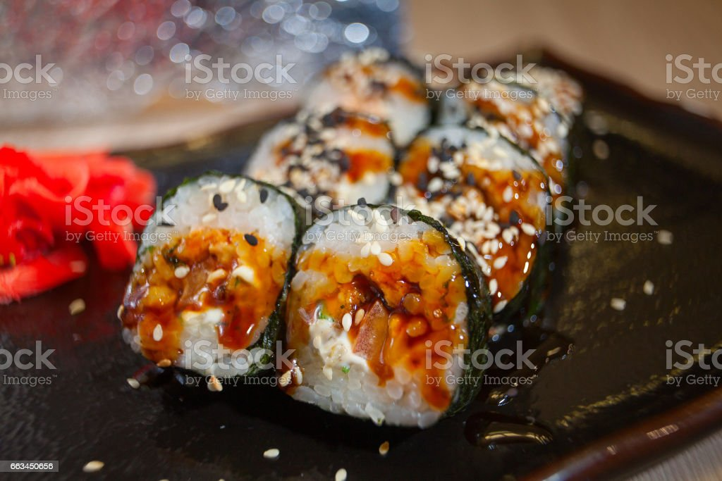 Japanese rolls with eel on black plate stock photo