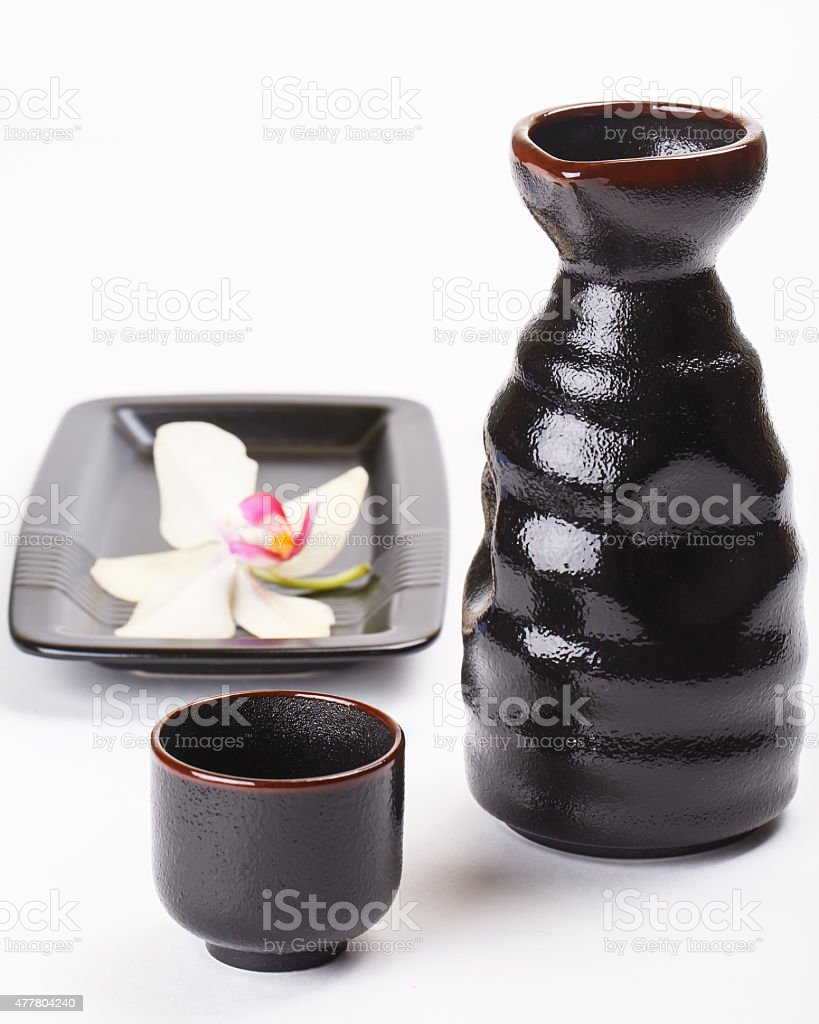 Japanese sake cup and bottle and orchid flower stock photo