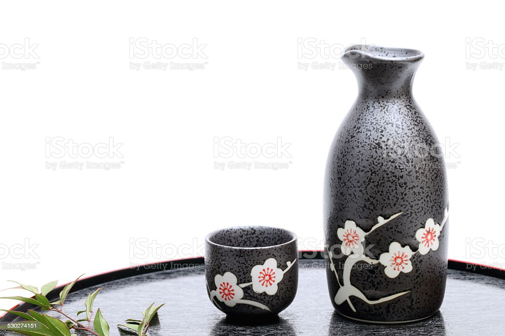 Japanese sake cup and bottle stock photo