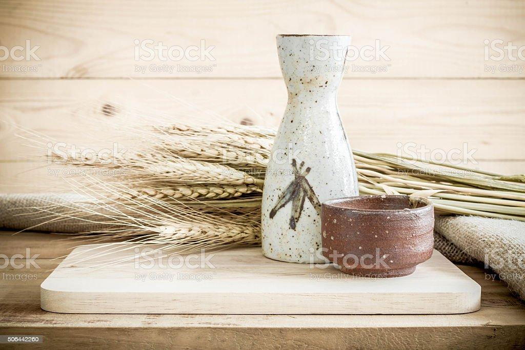Japanese Sake drinking set on wood texture background. stock photo