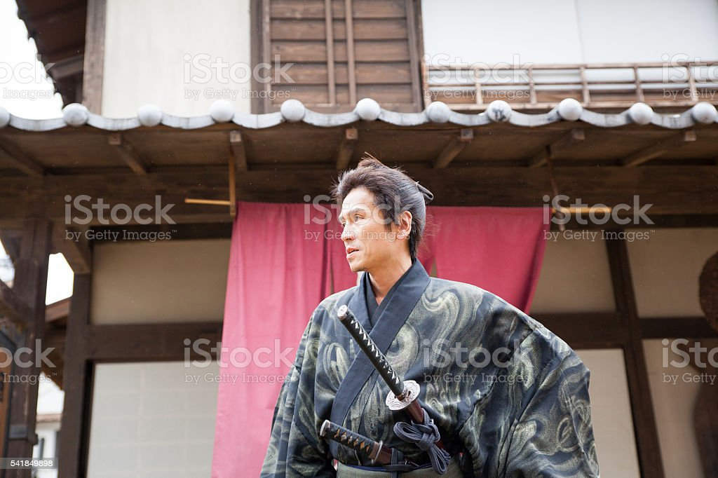 Japanese Samurai focused and ready for battle stock photo