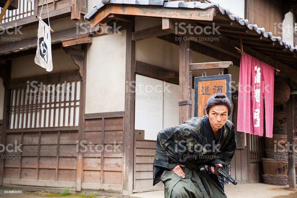 Japanese Samurai Warrior crouches for battle stock photo