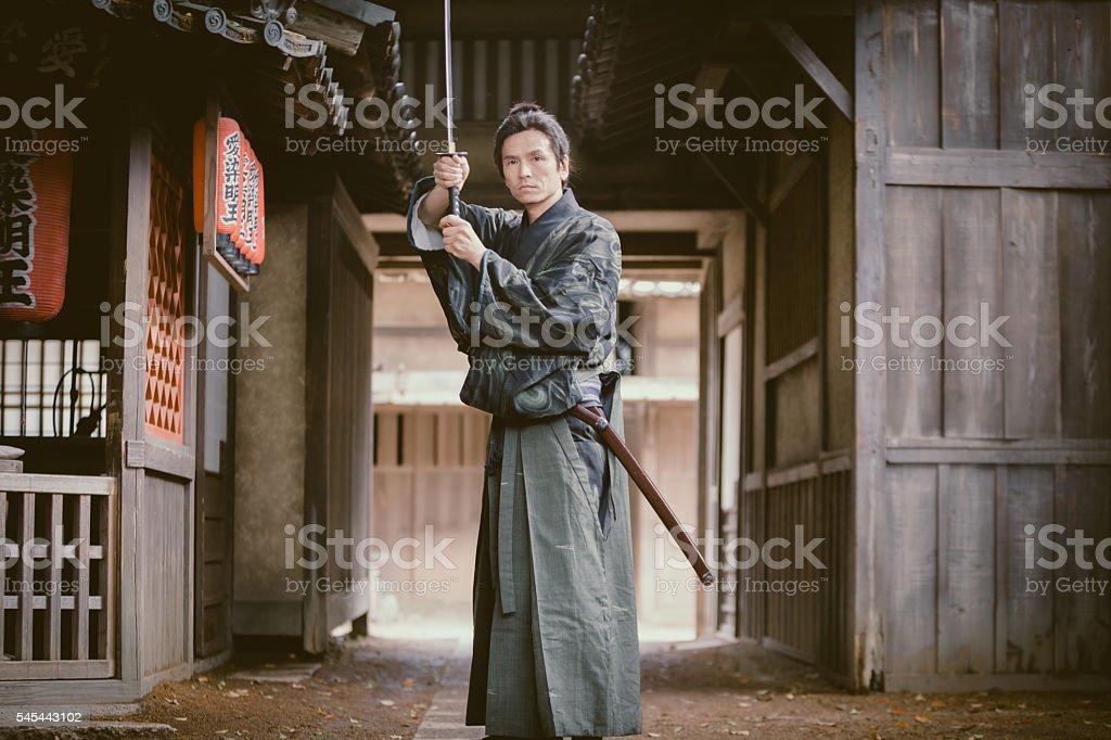 Japanese Samurai with sword ready for battle stock photo