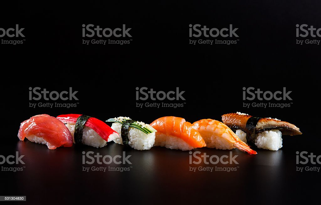 Japanese seafood sushi, on black background stock photo