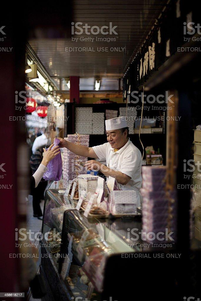 Japanese selling Ningyo-yaki cakes at Nakamise-dōri stock photo