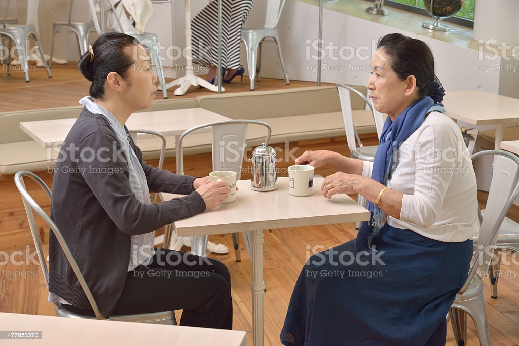 Japanese Senior Ladies Talking at a Cafe stock photo