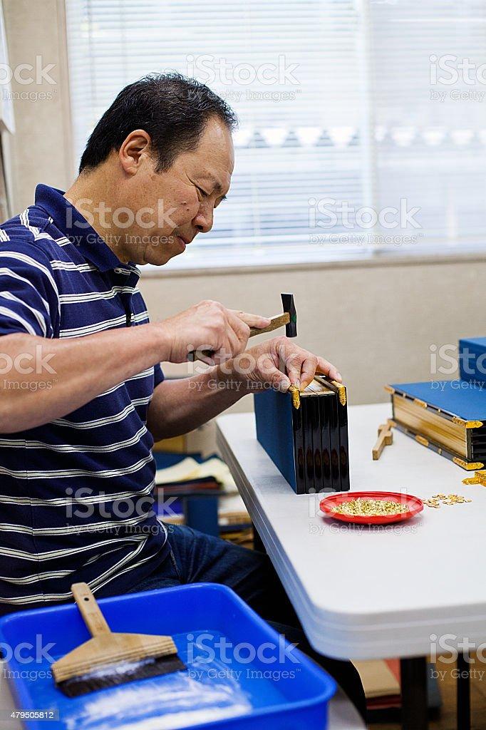 Japanese Senior man working handmade craft, Tokyo. stock photo