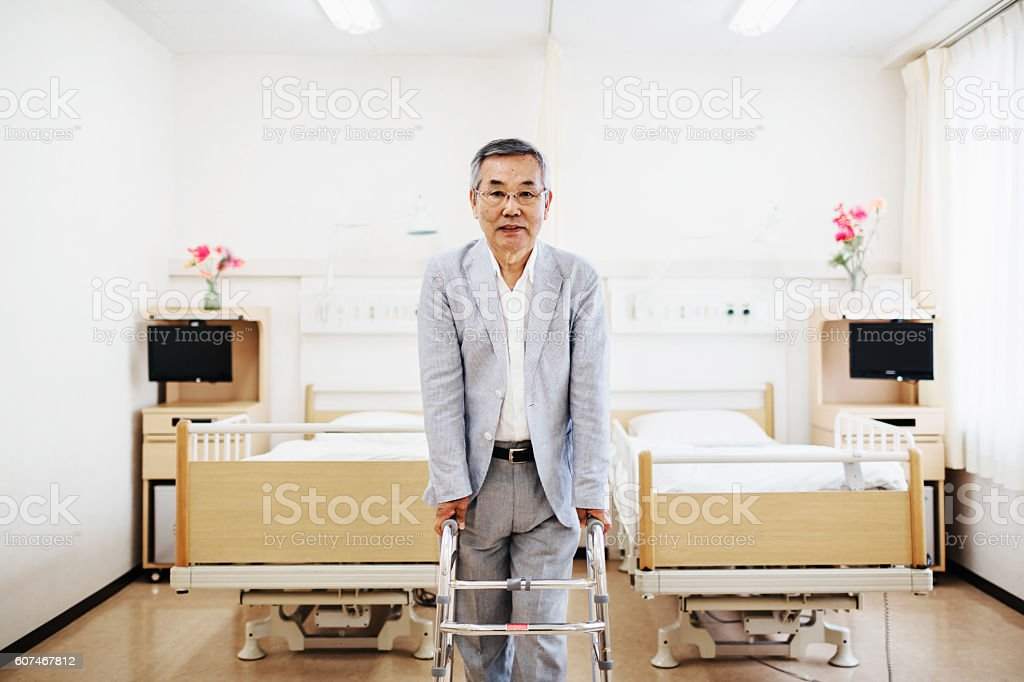 Japanese senior patient standing with walker stock photo