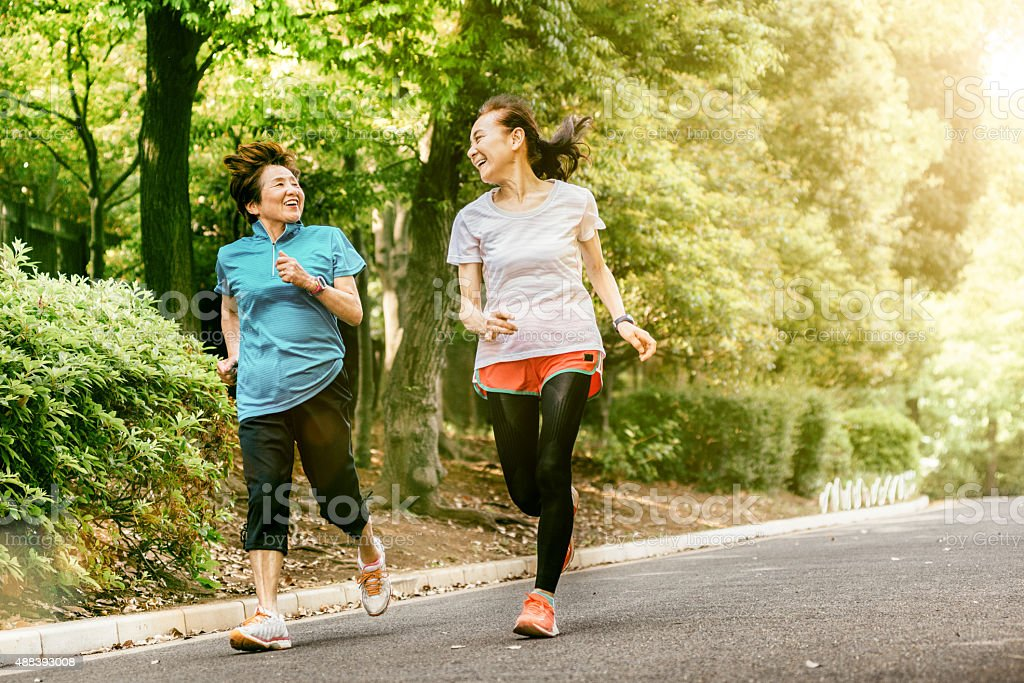 Japanese senior women running stock photo