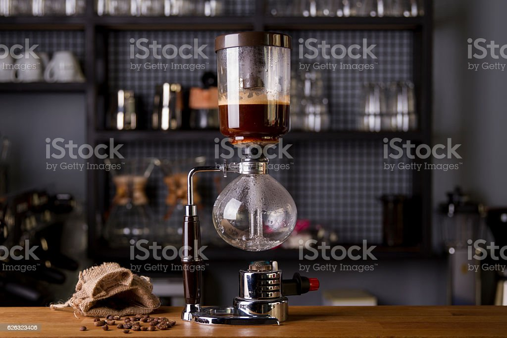 Japanese Siphon Coffee Maker with Halogen Beam Heater stock photo