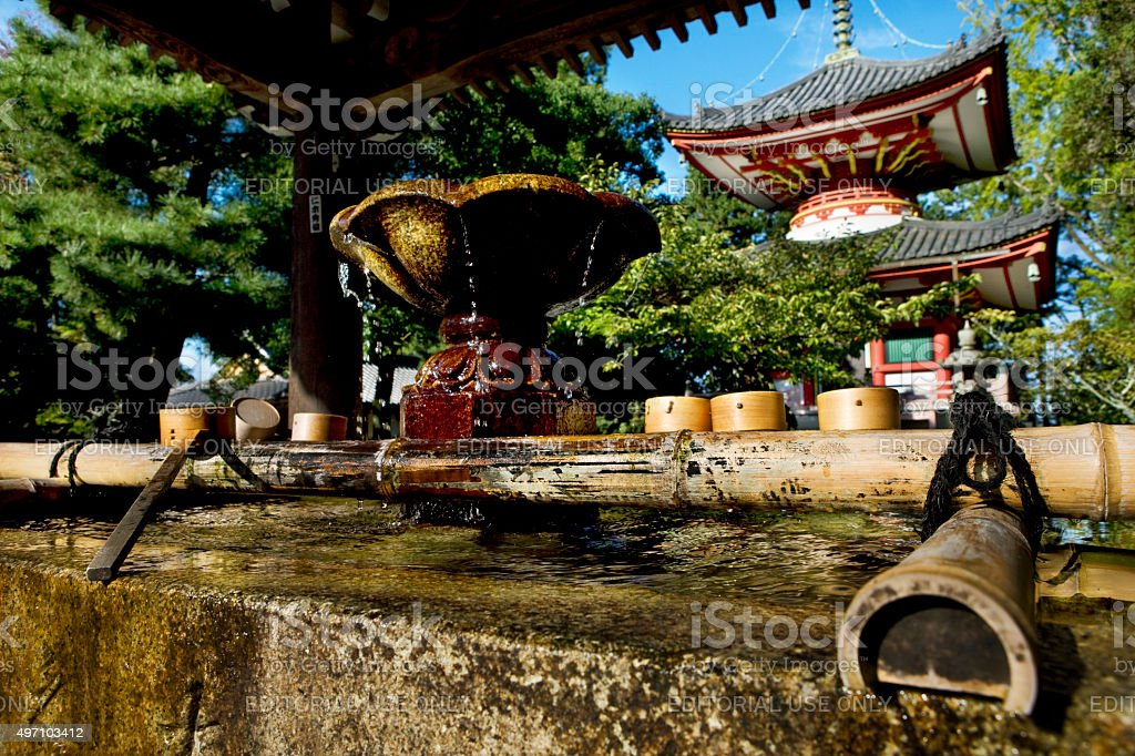 japanese spiritual fountain with bamboo dippers at Chion-in temple Kyoto stock photo