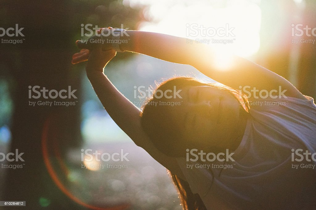 Japanese Sport Woman Exercising Outdoors In The Early Morning stock photo