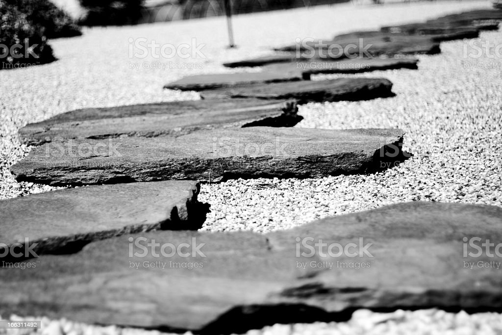 Japanese stone rocks acting as steps in a garden stock photo