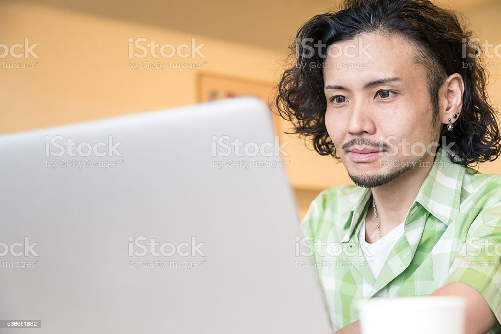 Japanese Student working on his laptop stock photo