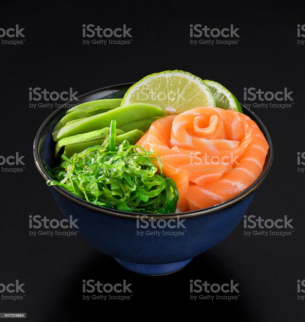 Japanese style seaweed salad with salmon, avocado and lime stock photo