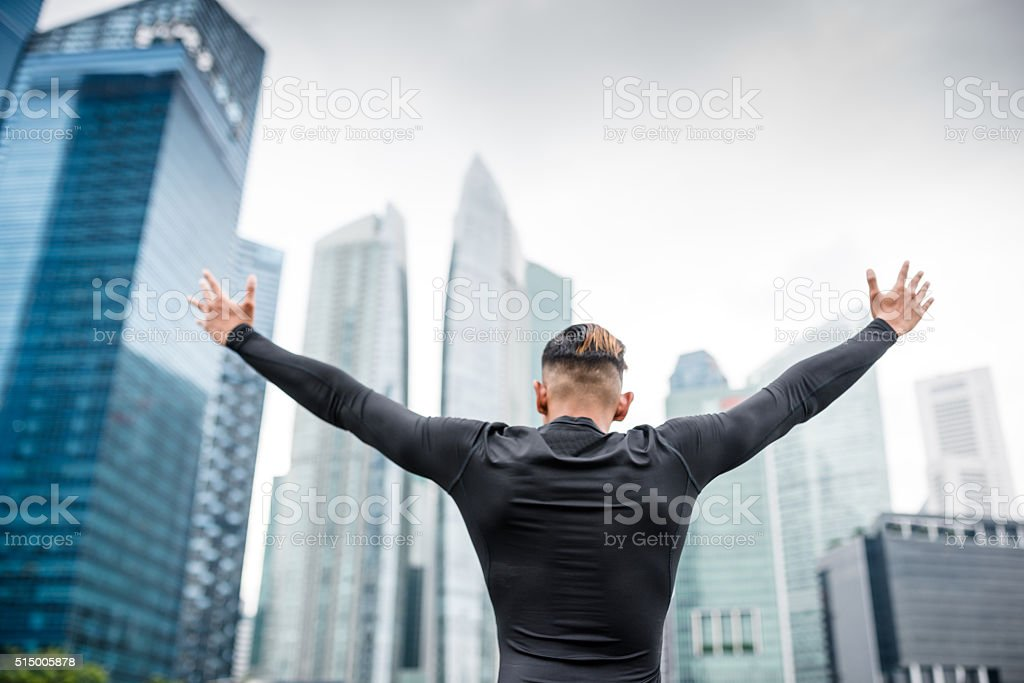 japanese success man praying on the downtown stock photo