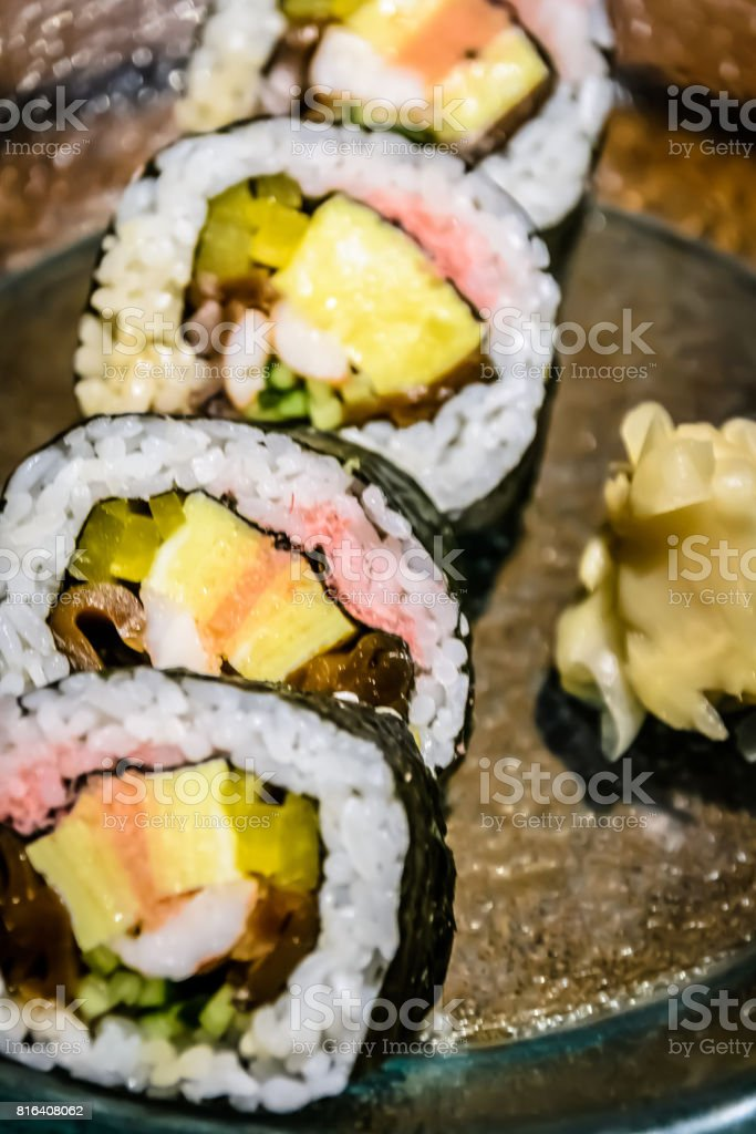Japanese suchi roll with pickled ginger stock photo