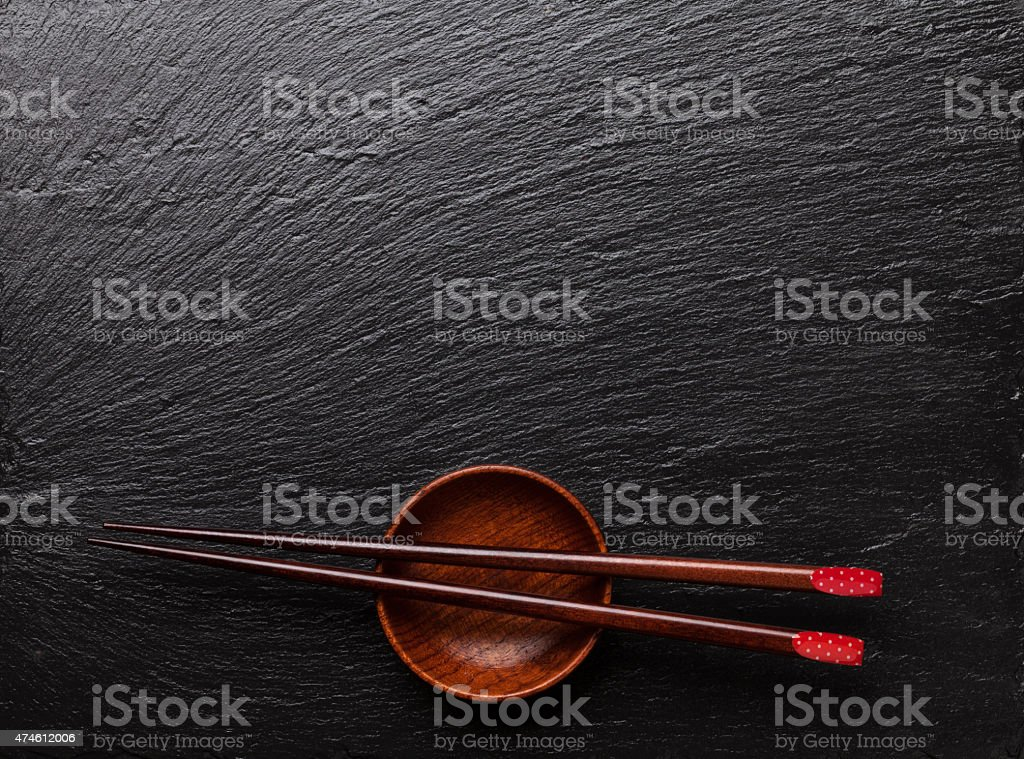 Japanese sushi chopsticks over soy sauce bowl stock photo