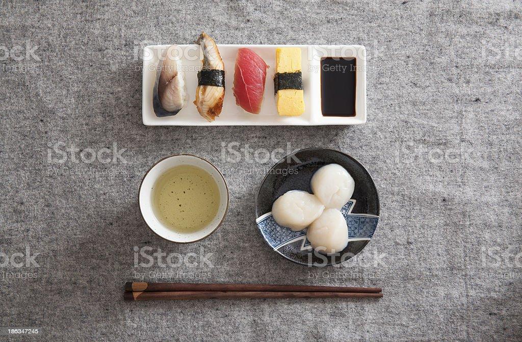 Japanese Sushi - Egg, Tuna, Eel, Swordfish, Scallop, Green tea royalty-free stock photo
