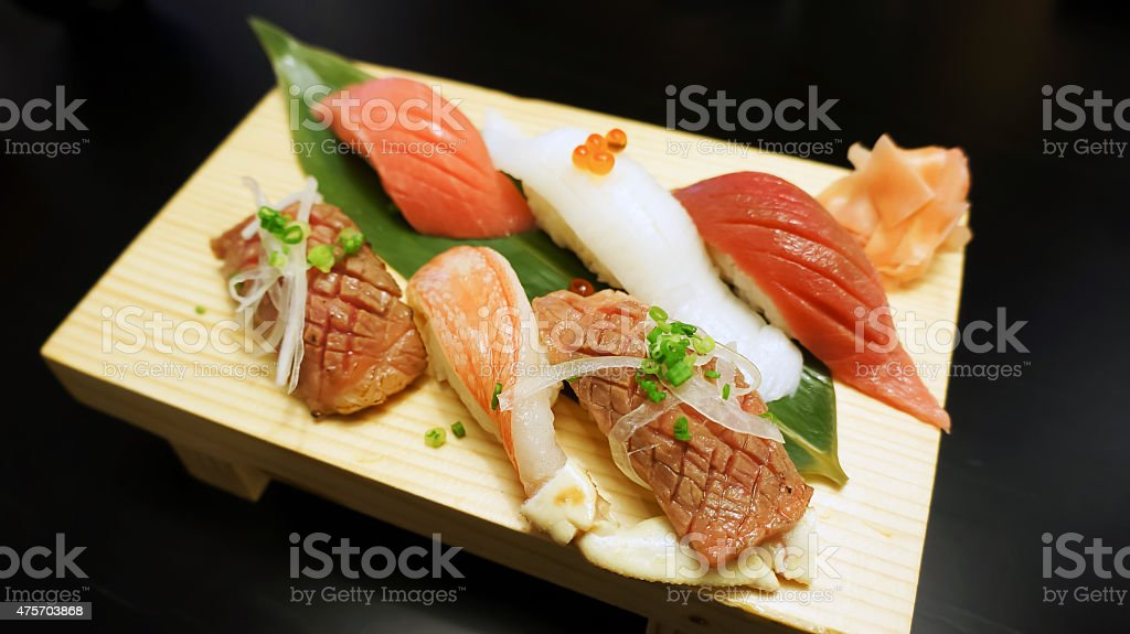 japanese sushi on wooden plate stock photo