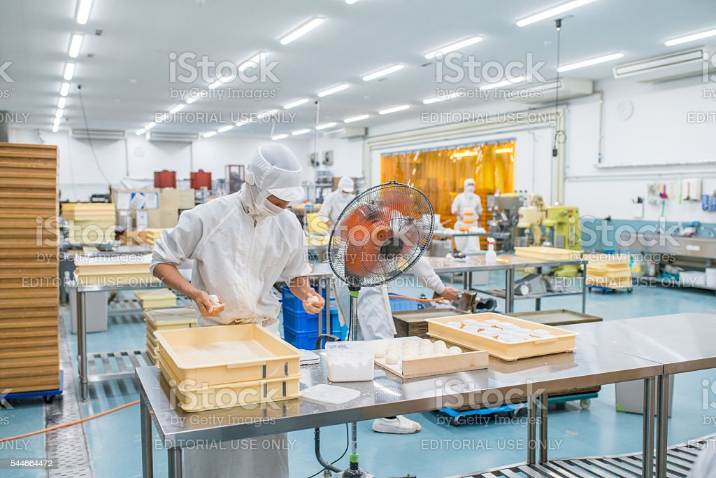 Japanese sweet factory workers stock photo