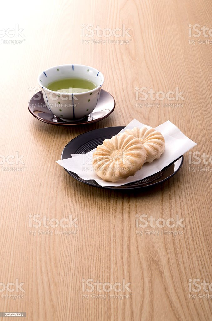 Japanese sweets called Monaka on wooden table stock photo