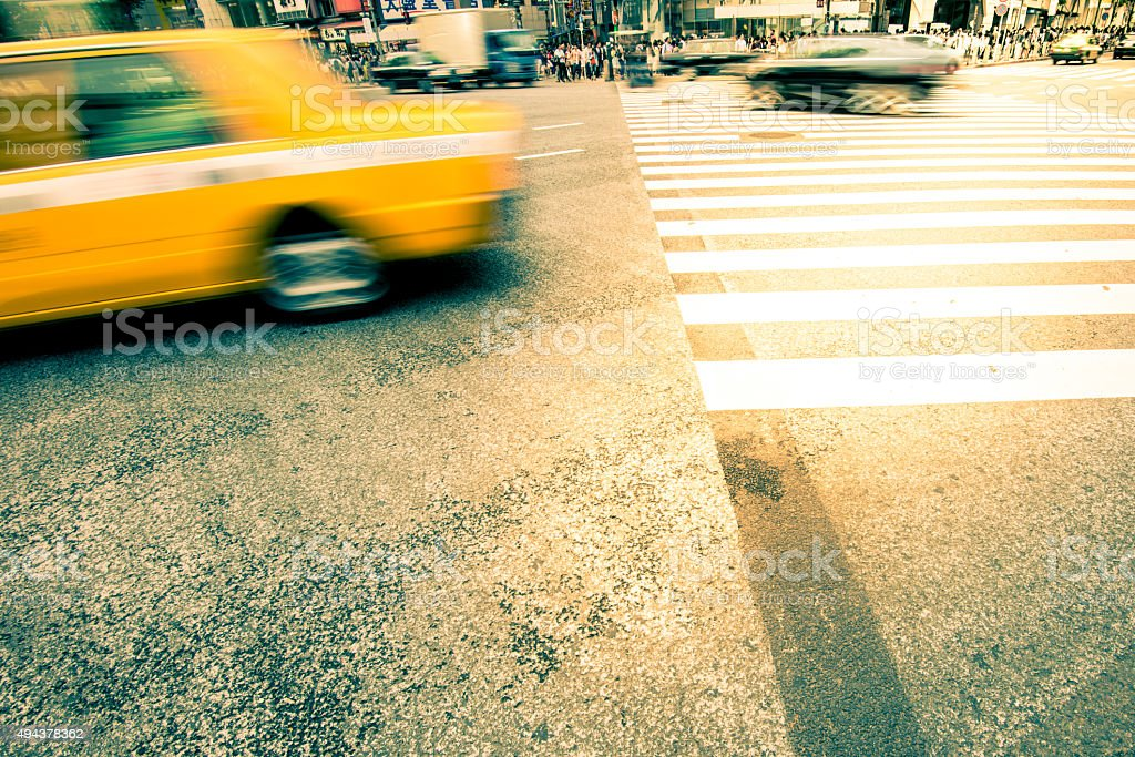 Japanese  taxi cars in motion at crossing stock photo