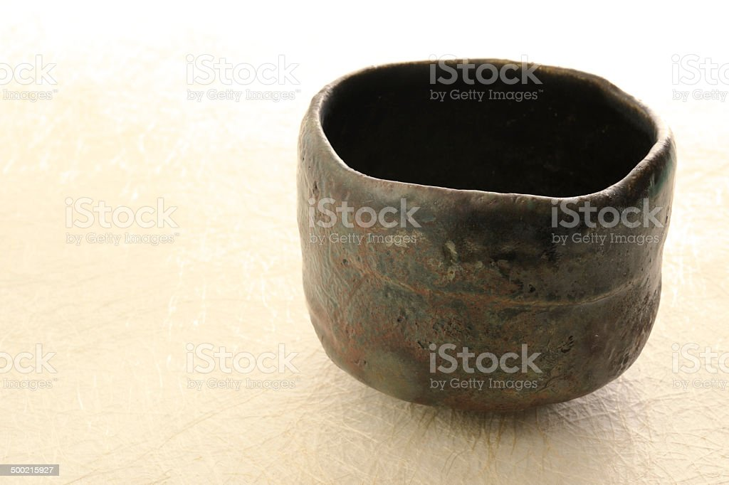 Japanese tea ceremony cup on rice paper with cory space royalty-free stock photo