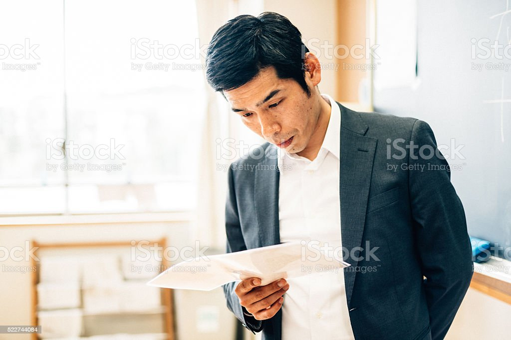 Japanese Teacher Preparing Before Class stock photo