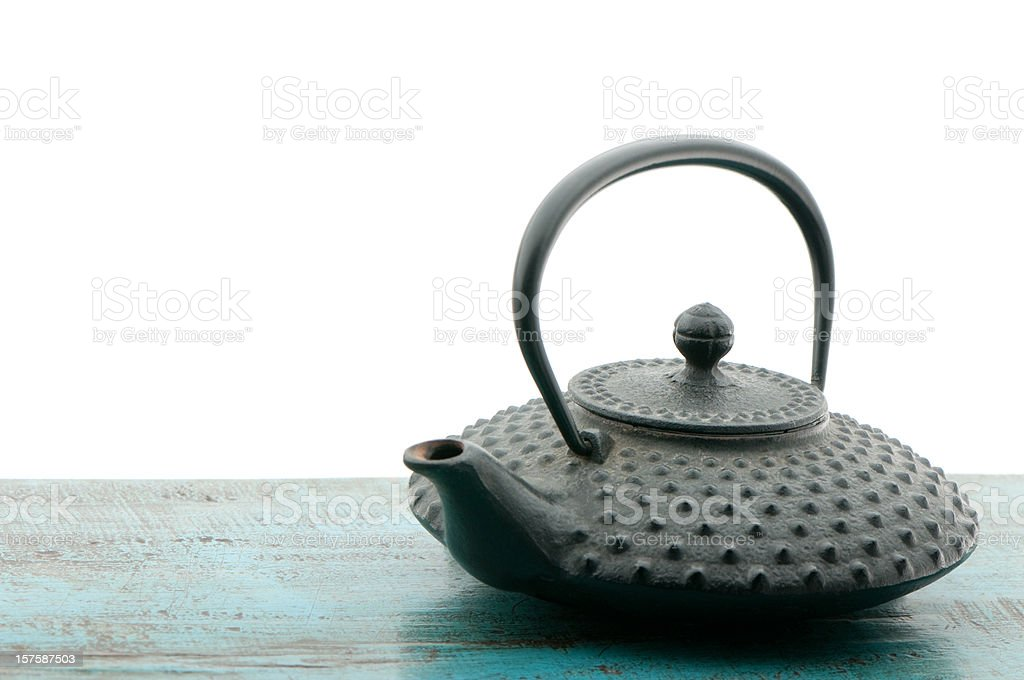Japanese teapot tetsubin, isolated on white background, copy space royalty-free stock photo