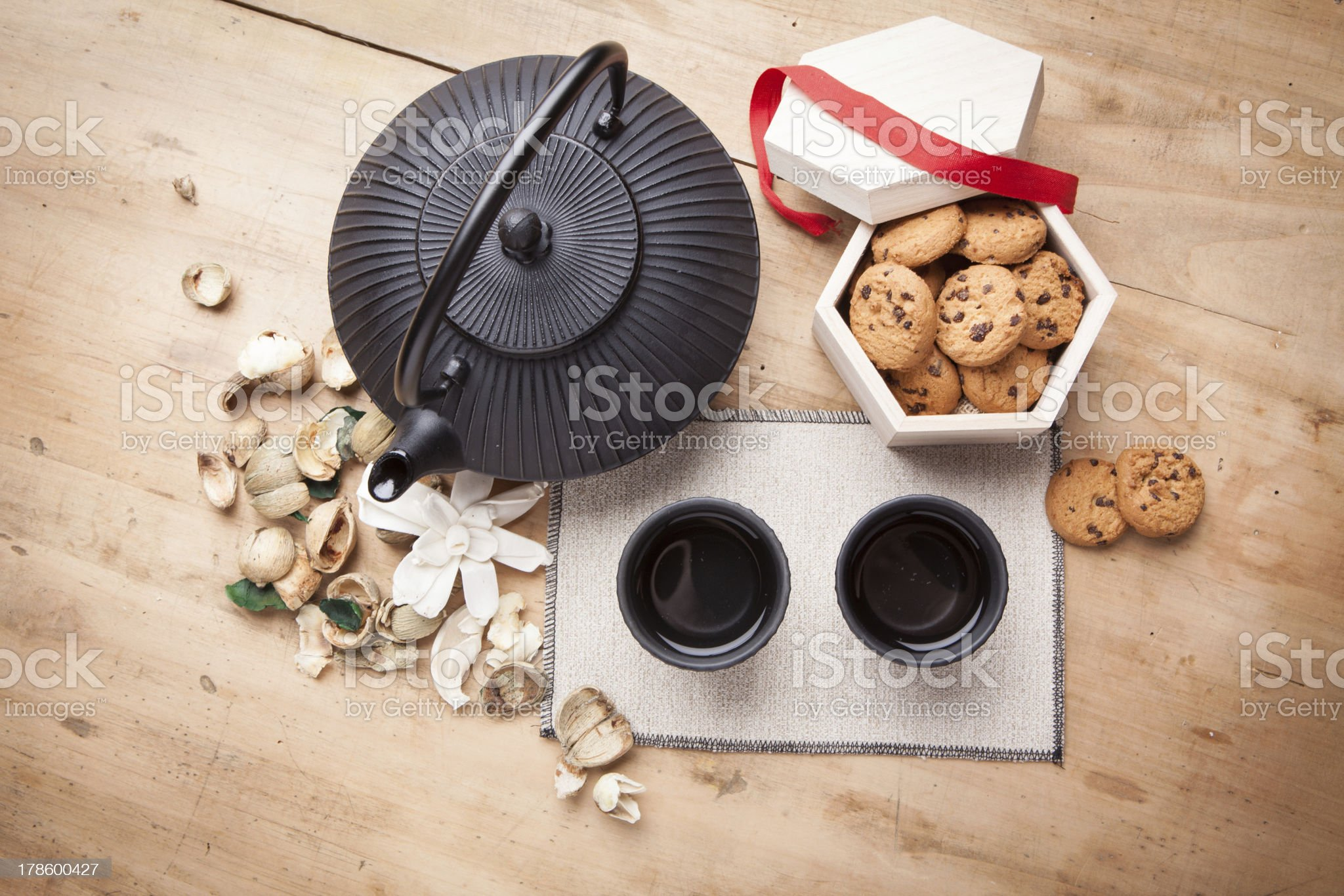 Japanese teapot with chocolate biscuits royalty-free stock photo