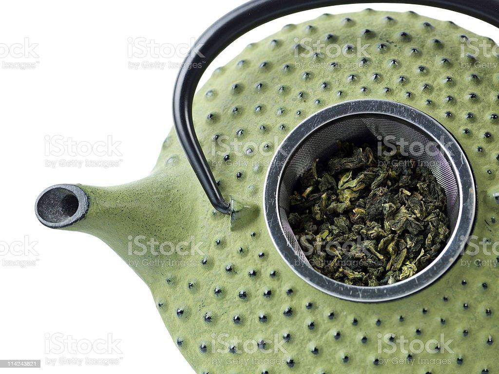 Japanese teapot with tea-strainer full of monkey picked oolong tea stock photo