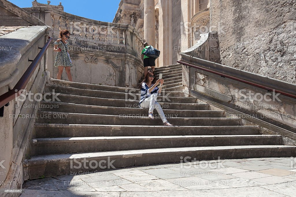 Japanese tourists sitting on Jesuits staircase stock photo