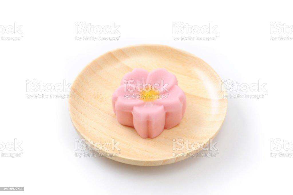 Japanese traditional confectionery cake wagashi on plate on white background stock photo