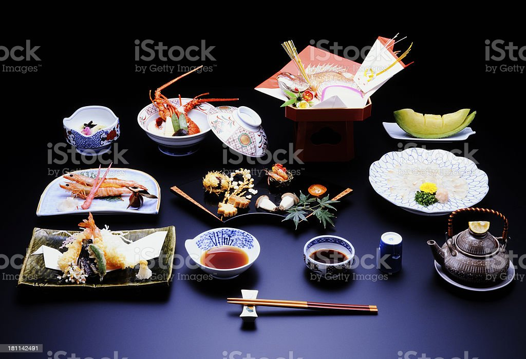 Japanese traditional cuisine on a black table royalty-free stock photo