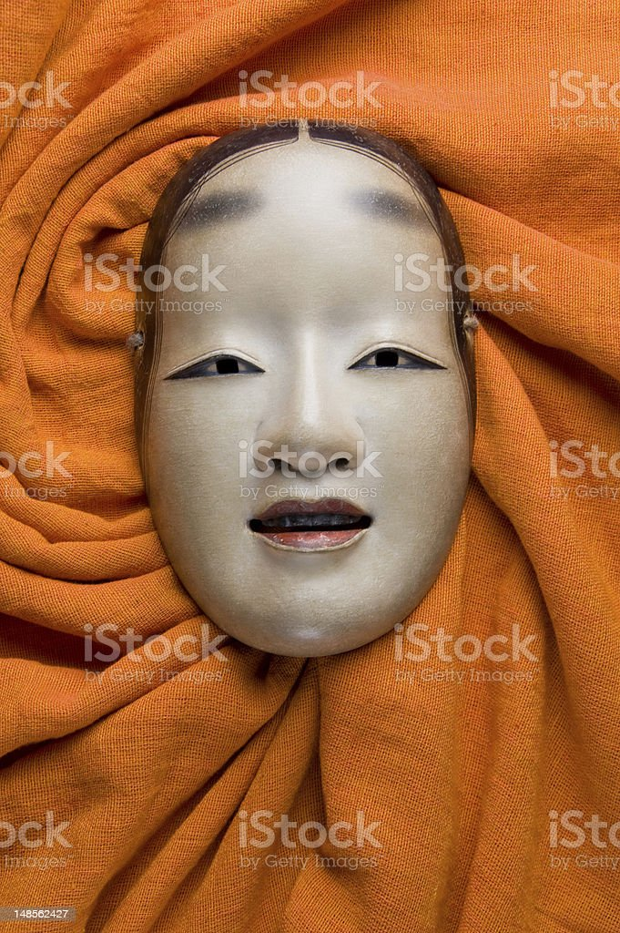 Japanese traditional face mask wrapped in orange cloth stock photo