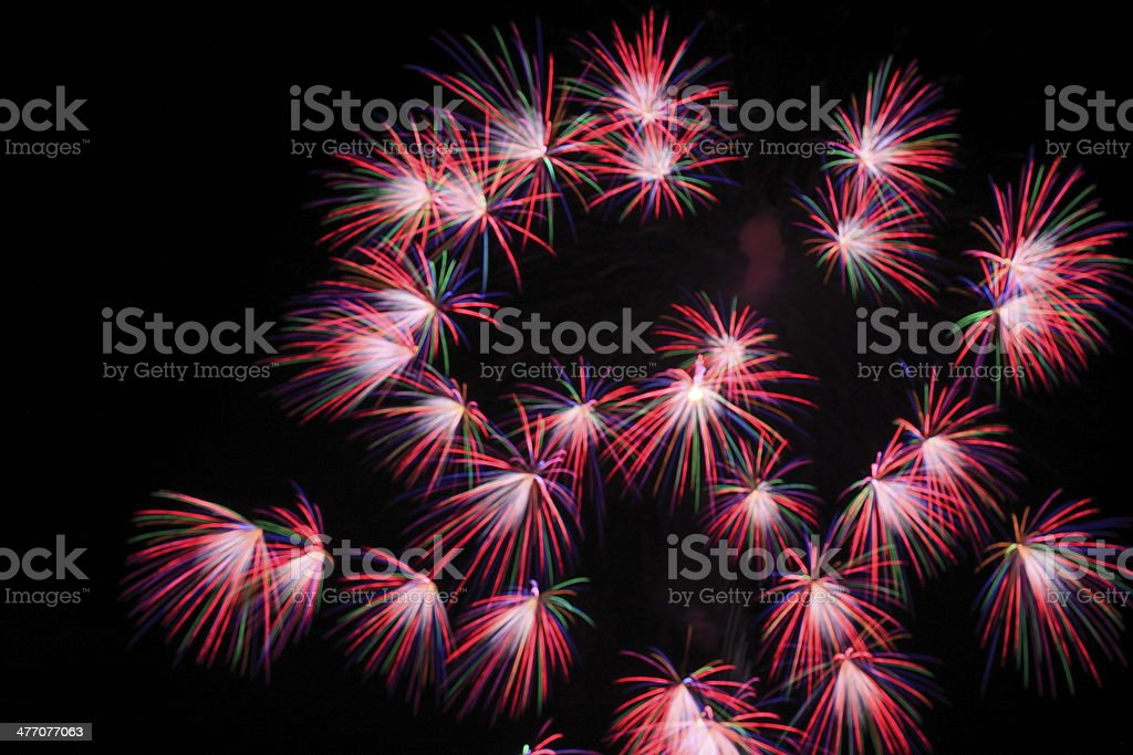 Japanese traditional fireworks in the night sky stock photo