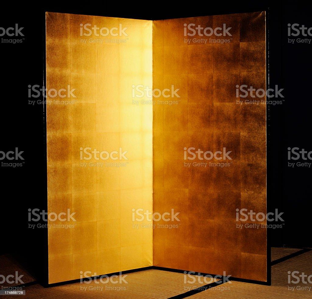 Japanese traditional gold folding screen on Tatami mat royalty-free stock photo