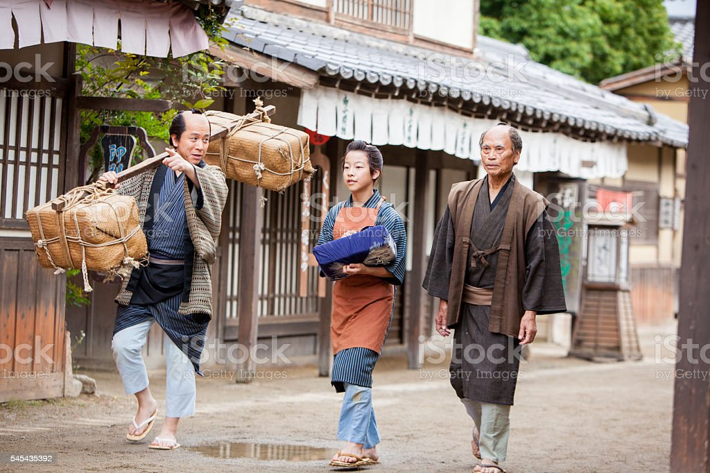 Japanese villagers walking down the street stock photo