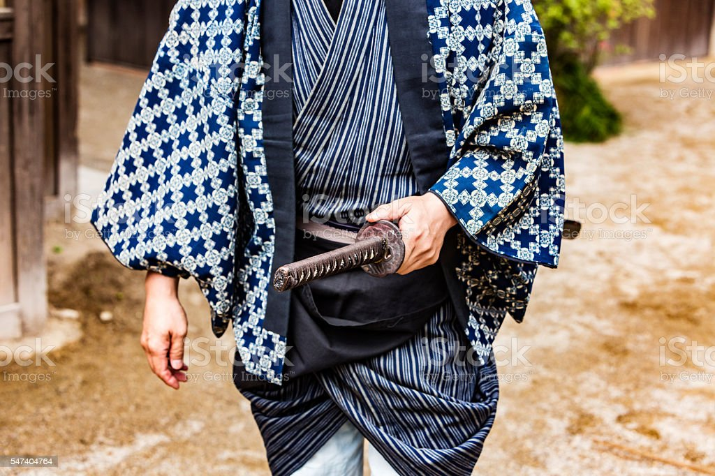 Japanese Warrior Drawing His Samurai Sword Katana stock photo