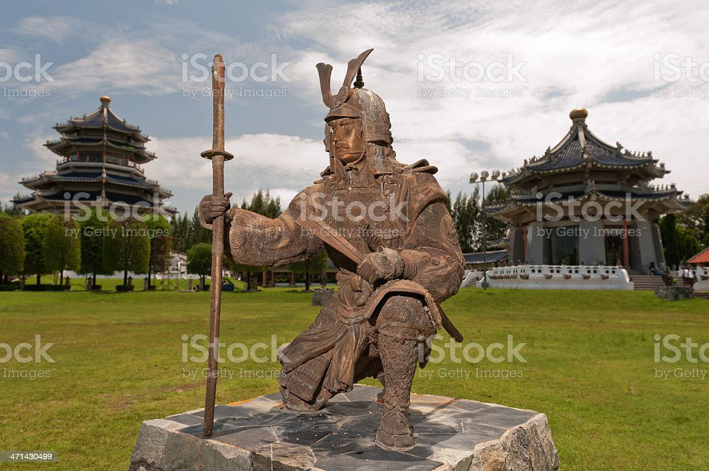 Japanese Warrior statue in front of chinese temple stock photo
