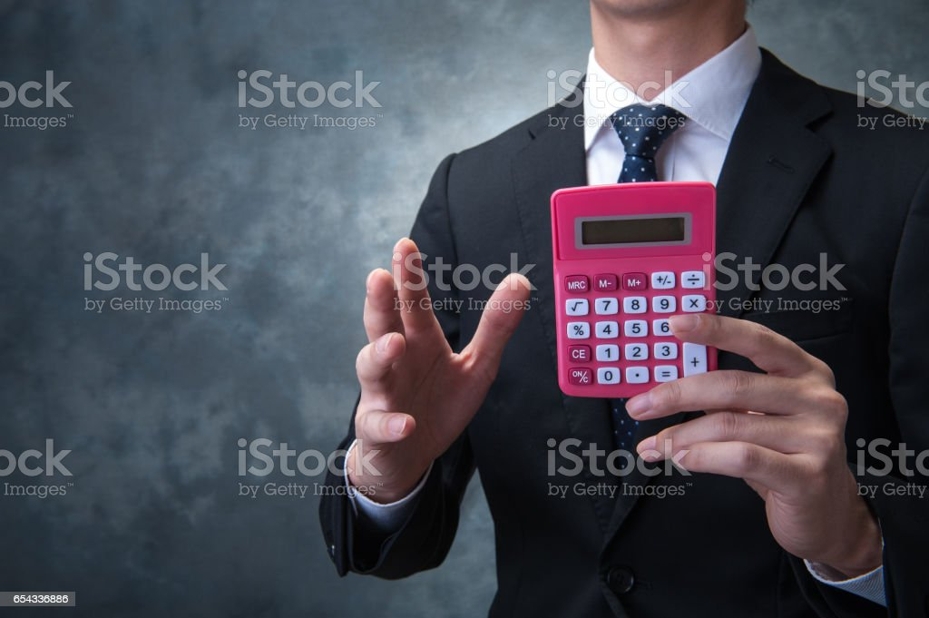 Japanese with pink calculator stock photo