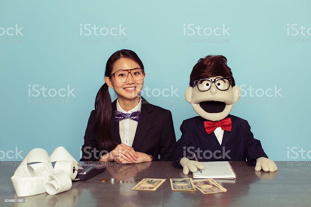 Japanese Woman Accountant and Puppet Associate stock photo