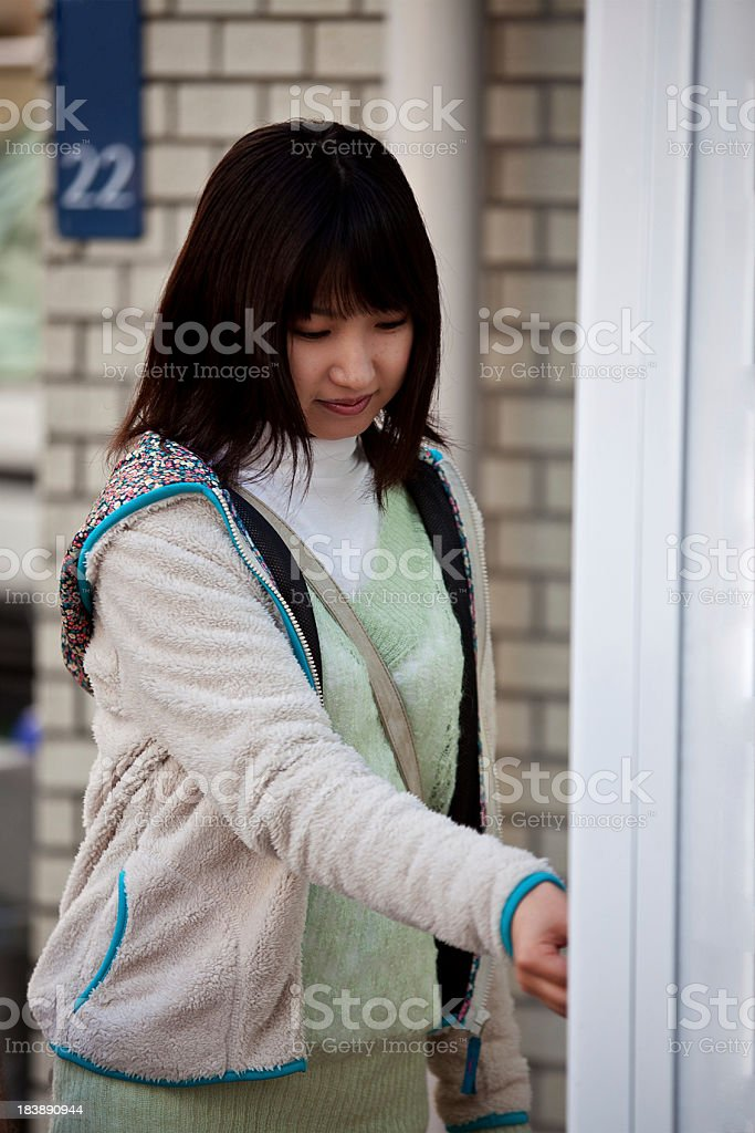 Japanese woman and vending machine royalty-free stock photo