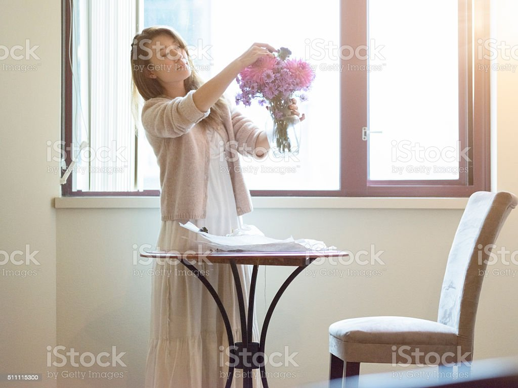 japanese Woman arranging flowers stock photo